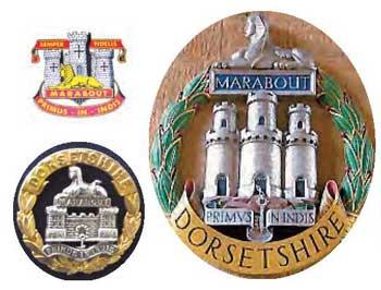 Cap badges of The Dorsetshire Regiment